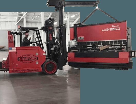 Forklift hauling a machine